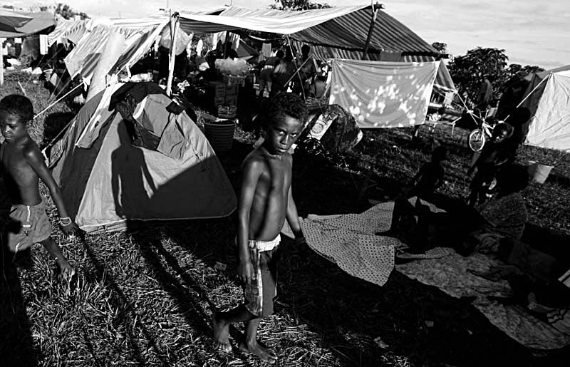 Young boys explore a makeshift  town camp atop the island of Gizo.© Sam Mooy 2007 for The Australian
