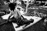 Injured residents from the island of Gizo wait to be treated at a makeshift hospital.© Sam Mooy 2007 for The Australian