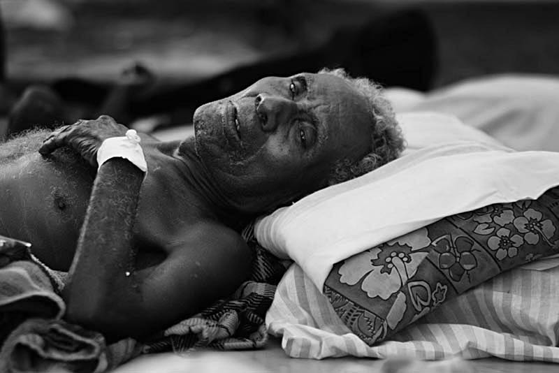 An injured elderly man  from the island of Gizo waits to be treated at a makeshift hospital.© Sam Mooy 2007 for The Australian