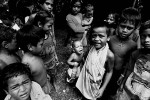 A young child suffering from Cholera and Diaorrhea waits to be treated in a town camp.© Sam Mooy 2007 for The Australian