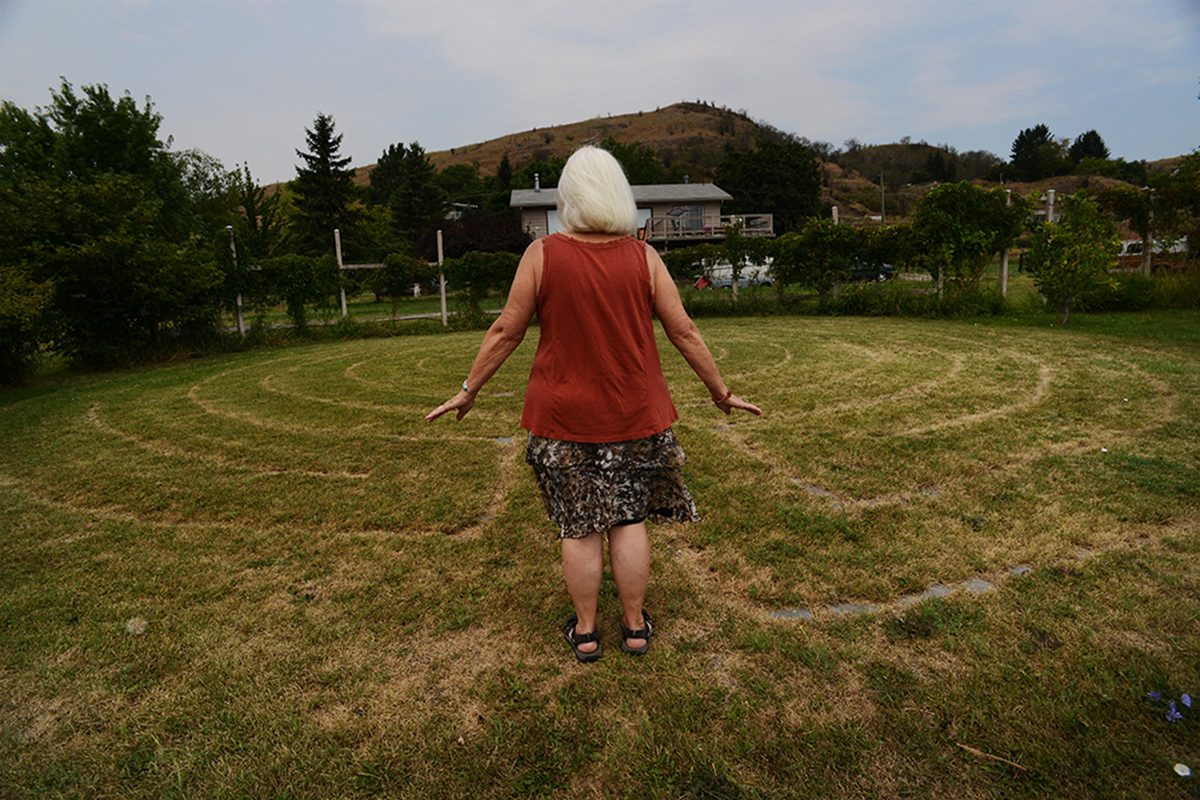 Artist Akira Ellen Hanson walks her labyrinth on the edge of Swan Lake.