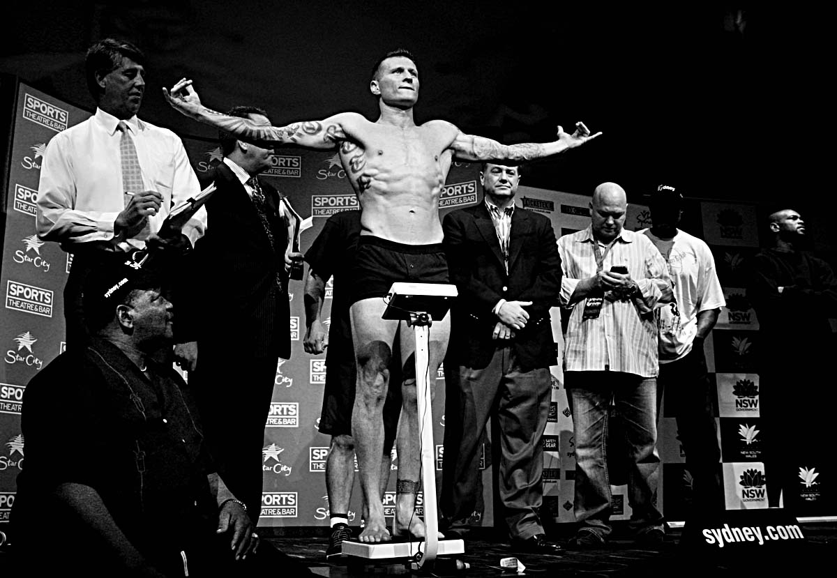 Green appeals to the audience for applause as he steps on the scale, watched by boxing officials and Roy Jones (left), son and opponent Roy Jones Jnr (far right), at a sports-bar in Pyrmont, Sydney a day before the fight. All pictures © Sam Mooy/NEWS LIMITED 2010