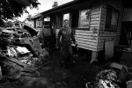 An Australian army soldier surveys the damage  and takes time for pause during aiding the recovery of Grantham residents after the 2011 Queensland floods.  © Sam Mooy 2011