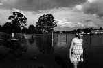 A local girl walks through her backyard, during flooding in the town of Brushgrove, New South Wales. © Sam Mooy 2011