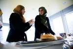 Reema and Asmaa take a moment to catch up while making sandwhiches for a local homeless shelter with the University of Toronto Muslim Student Association.