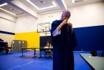 Huda puts on her gown while getting ready for her graduation from Ryerson University.