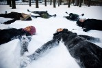 Asmaa and her friends make snow angels on the grounds of the University of Toronto.