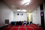 Women pray in a separate area of the Masjid mosque during Juma prayers.  The Imam's prayers are broadcast over a closed circut television system.