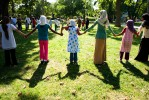 Young Muslim girls play Red Rover at a BBQ organized for Muslim youth in the Regent Park area of Toronto.