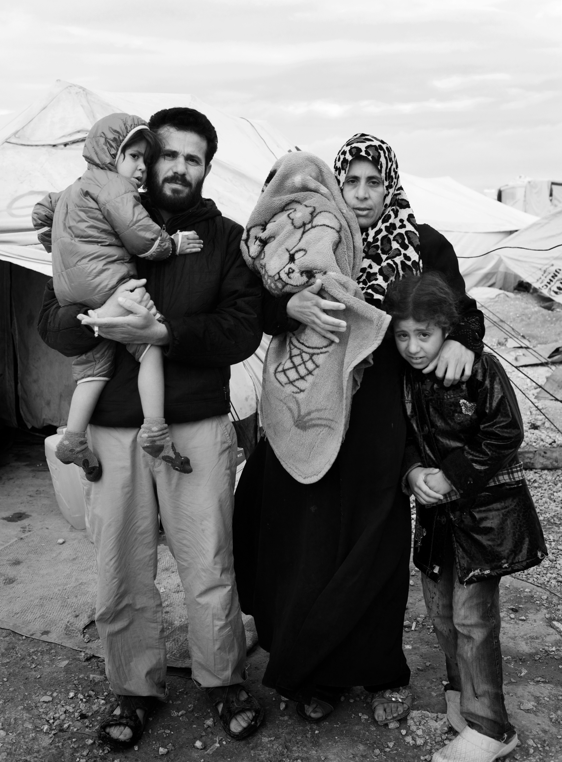 Amin and Siwar with Mayam, 8, Salwa, 4 and 8 month old Safa who was born in the camp.
