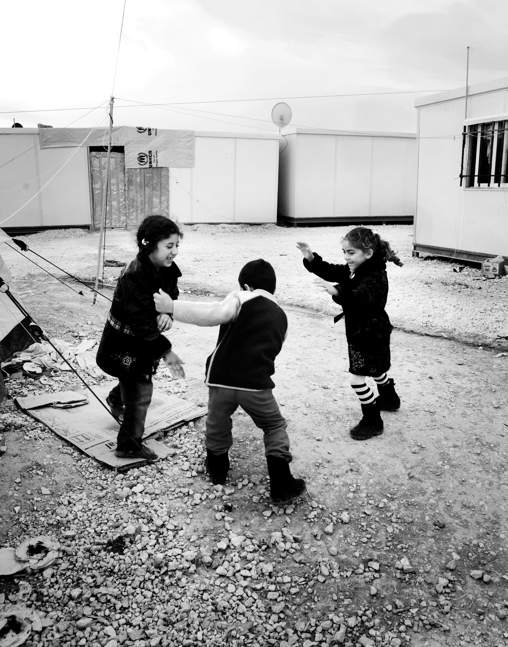 Mayam playes a game of catch with her cousins Ameer and Inas