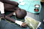 At the MSF clinic in Pieri, a boy fights for his life after being shot through the liver. Due to his loss of blood, the doctor was unable to stabilise him in order to get him to a surgery. The nearest being over two hours flight.