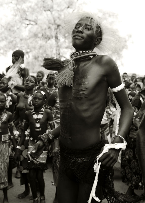 To signify his status as a warrior, a Murle youth wears a headpiece made from the mane of a lion. The lion has to be killed by hand.