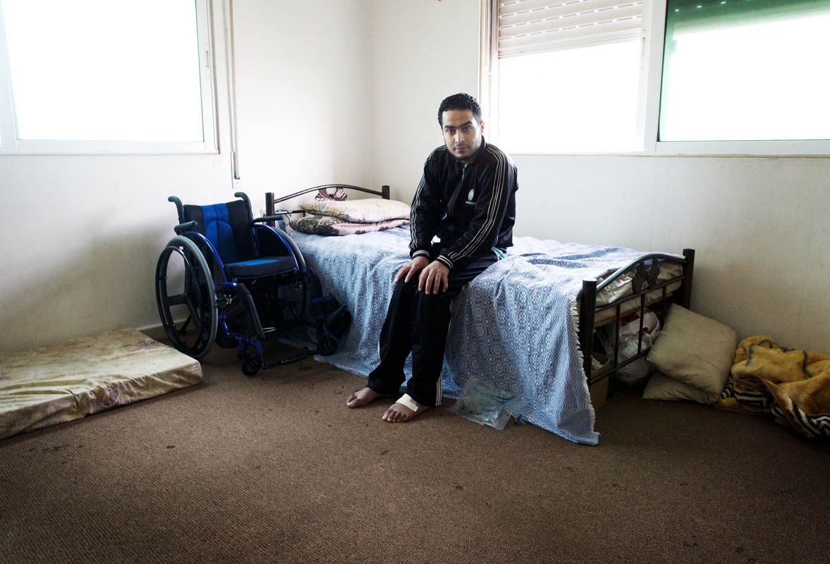 Paralysed by a bullet whilst fighting in Damascus, 22 year-old Shaher is now confined to a wheelchair. He lives on the 4th floor of an apartment block in Jordan that has no lift and is cared for by his family. Despite being told he will never walk again, he is determined to prove the doctors wrong and dreams of returning to Syria.