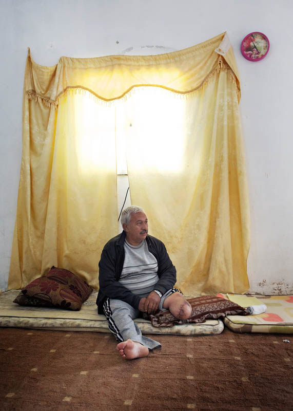 A farmer rests in the home he now rents in Jordan. One night, a few months before, the lights suddenly went out in his farm. An hour later rockets hit and destroyed the building. His daughter was killed and he lost his leg.{quote}I lost a child and a leg, at least I still have one of each{quote}