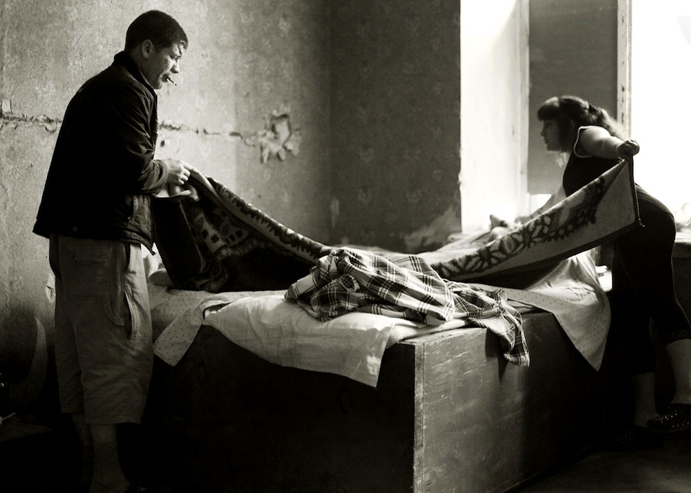 Sasha making his bed with Lydia. They are a couple.