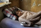 Lydia sleeping in the house. They often sleep through the day as the nights are spent drinking and making money.