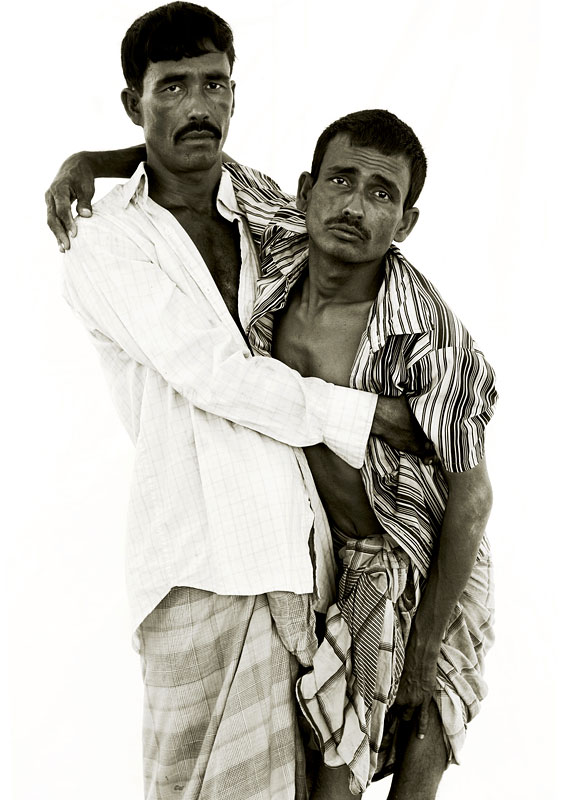 Fir Ahamad 30, and his brother Noor, 40.Fir suffers from an unknown illness causing severe joint painWith the upper body of a wrestler and a diamond-shaped knife wound on his chin, Noor carries his younger brother into the interview and lowers him gently onto the cracked plastic chair, an action that causes Fir to wince and whimper with pain. The wasting disease that has reduced him to a bag of fragile bones first began to take hold in Burma, where Fir was working as a forced labourer. {quote}Every time I fell down the guards would beat me,{quote} he says. {quote}Eventually I couldn't tell where the pain of the beatings stopped and the disease began.{quote} Stern-faced Noor squeezes his brother's hand as tears fill his eyes. {quote}Every night I lay down hoping I may die in my sleep,{quote} says Fir, {quote}so that I may be released from this pain.{quote}