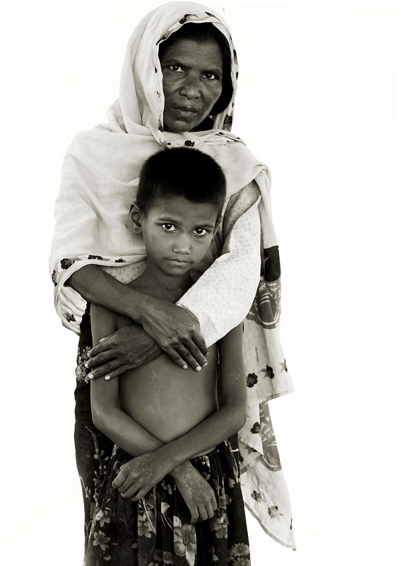 Asia Begum 55, and grandson Min Ara, 7.Min has suspected jaundice and liver problems.Young Min Ara's ear still bears a smear of black marker pen from the previous day, a sign he queued with thousands of other children in the sweltering heat to see a handful of Medecins Sans Frontieres doctors administering innoculations against measles and polio. His grandmother, Asia, weeps when she recalls the trouble they had marrying off their daughter, Min's mother - the Burmese government expects the impoverished Rohingya to pay for pricey marriage licenses - only for the husband to be then arrested for failing to turn up to a forced labour camp. He remains in a Burmese jail to this day, and the family anxiously awaits news of his release so that he may join them in the camp.