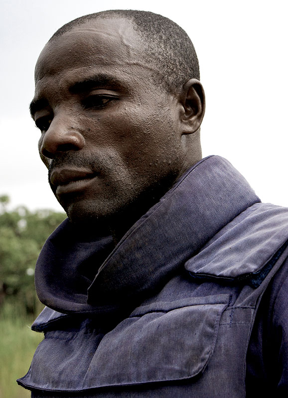 A young Angolan de-miner, takes a rest while the village is assessed.