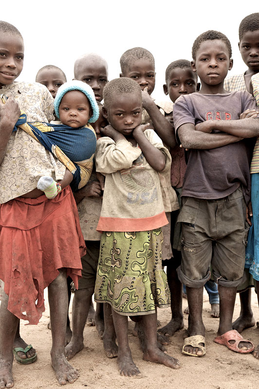 Children gather at the resettlement camp in Lunachi.These refugees returned to Angola only for floods to destroy their homes. They are now living in tented villages supplied by IOM.Cazombo, 2007