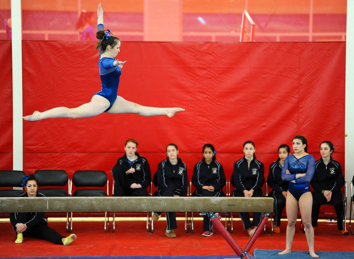 Shrewsbury junior Maddie Konz performs her balance beam routine during the MIAA South Sectional Gymnastics Tournament in the Hudson High School gymnasium on Saturday, Feb. 21, 2015.