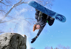 Parker Szumowski, 19, of Plymouth, N.H.  flips over a stump on his snowboard at Elm Park on Friday, Feb. 27, 2015.