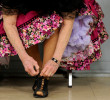Peggy Kelley of Hyannis ties her dancing shoe before the Nau-sets square dance at Dennis Senior Center on Tuesday, March 4, 2014.