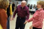 Bob Jones of East Dennis reunites with old friends at the Nau-sets square dance at the Dennis Senior Center on Tuesday, March 4, 2014. Jones stopped attending after his wife passed but decided to return this evening.