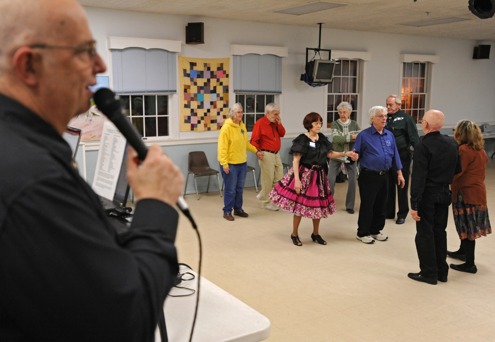 Caller Charlie Trapp of Halifax recites the dance steps during the Nau-sets square dance at the Dennis Senior Center on Tuesday, March 4, 2014.