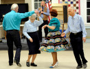 Dave Kelly spins Ruth Tilley while Peggy Kelley  and Jim Tilley promenade during a Nau-sets square dance.
