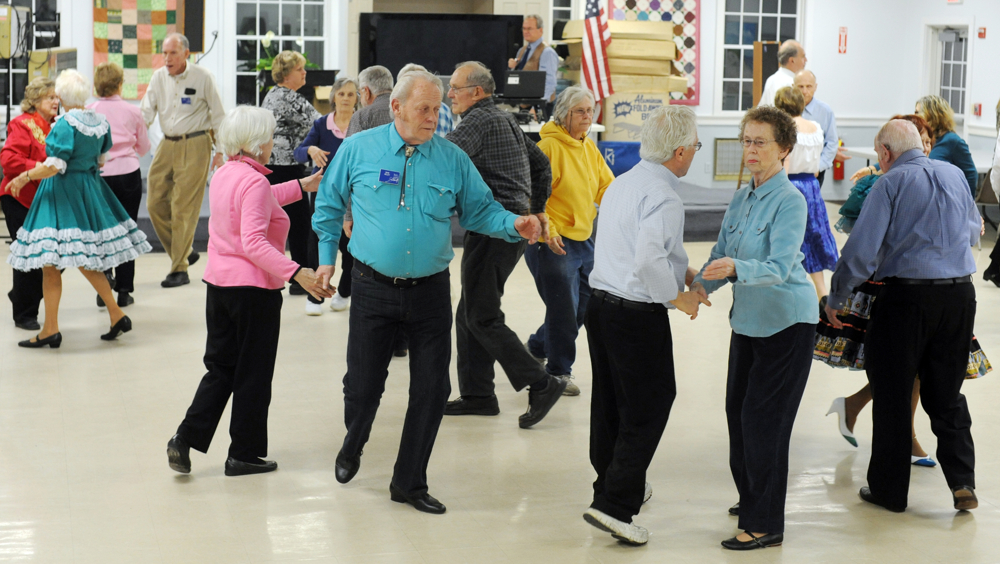 The Nau-sets square dancing club gets three squares moving on a Tuesday night at the Dennis Senior Center. Four couples make a square and dances in patterns designed by the caller.