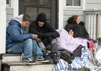 HYANNIS - Clients of St. Jospeh House wait on the front steps for the shelter for the daily 3:30 opening on Monday, March 30, 2020. The Barnstable County Department of Human Services is working with other area nonprofits to accommodate shelter overflow during the pandemic.