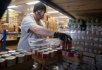 JOINT BASE CAPE COD - Andrew Enos, volunteer for disaster response NGO, Team Rubicon, helps pack boxes with a 14-day supply of food for veterans and their families on Thursday, April 2, 2020. This Food4Vets is organized by the Massachusetts and Cape Cod Military Support Foundations and has a goal of distributing 50,000 boxes.