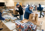 HYANNIS - Town of Barnstable municipal golf course employees fill bags of groceries for seniors at the Adult Community Center on Friday, April 3, 2020. The crew was tasked with putting together 240 bags of food to be delivered to seniors.