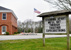 CENTERVILLE - Poignant message on the C.O.M.M. Fire Department Headquarters sign board.