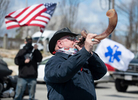 HYANNIS - Mike Rodericks blows into a shofar to mark the beginning of the Good Friday prayer service honoring healthcare workers in the Cape Cod Hospital parking lot on Friday, April 10, 2020.