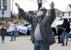 HYANNIS - Todd Jenkins prays for healthcare workers with fellow well-wishers from the Cape Cod Hospital parking lot on Friday, April 10, 2020.
