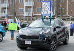 HYANNIS - Brooke Foster shows her sign of support for healthcare works from the the Cape Cod Hospital parking lot on Friday, April 10, 2020.