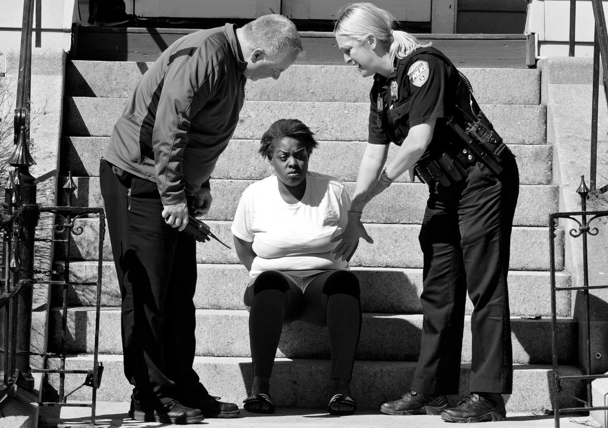 Police speak to Rosa Ball who was arrested at the Friendly House Shelter, 87 Elm Street, in connection with stabbing in front of the former PIP shelter on Main Street on Wednesday, April 15, 2015. She was charged with armed assault with intent to murder and assault and battery with a dangerous weapon