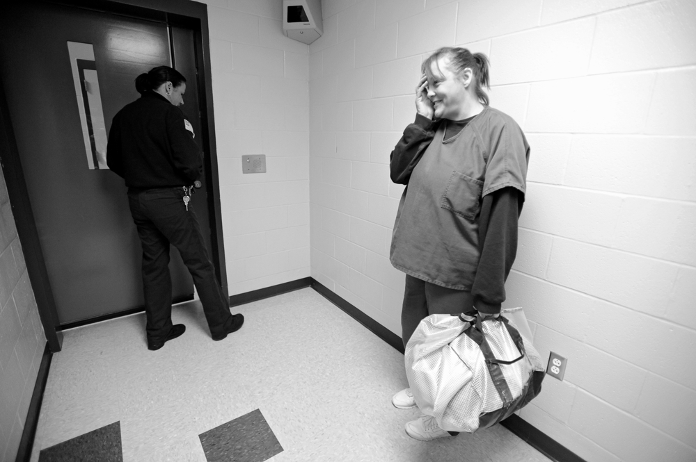 Deputy Robin Cote unlocks the door to begin the process of Desiree Azarian release from the Barnstable Correctional Facility after her 20-month sentence for her 5th OUI.