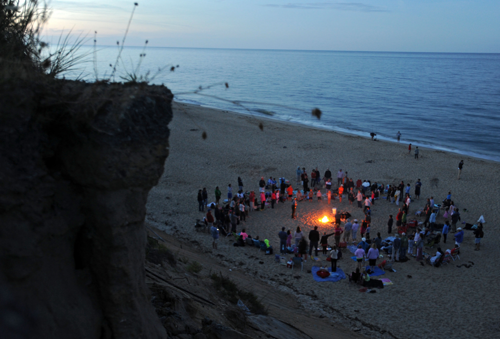 8:05 p.m. -- Cape Cod National Seashore interpretive park ranger Valerie Bell tells a story from the Nauset tribe around a bonfire at Nauset Light beach on Wednesday, August 20, 2014. The Salt Pond Visitor Center holds a campfire every Wednesday evening in July and August. Individuals can also inquire about obtaining permits to have their own bonfires.