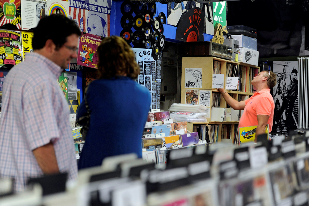 8:27 p.m. -- Frank Hunter of Nantucket, far right, checks out the vinyl selection at Spinnaker Records with The Clash, Big Brother and the Holding Company and The Specials already cradled under his arm on Monday, August 25, 2014.  He is a guitarist in the band Cranberry Alarm Clock.