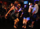 10:03 p.m. -- Dragalicious Karaoke host Dana Danzel dances with Juliana Oliveira of South Yarmouth while singing the pop song {quote}Everybody Talks{quote} at Embargo on Wendesday, August 27, 2014.
