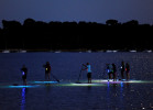 7:44 p.m. -- Justin Labdon of Adventure Chatham leads a twilight stand-up paddle boarding {quote}glow{quote} tour in Pleasant Bay on Thursday, September 4, 2014.  The paddlers are equipped with LED lights kits that light up the bottom of the boards.