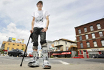 Fatal truck crash survivor Joseph Meszaro of Oxford stands in Kelley Square on Thursday, June 25, 2015. Meszaro is learning how to walk again after both of his feet were broken in the accident.