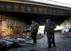 AIDS Project Worcester outreach educators Jason Newton and Dan Aponte look for disgarded syringes on Friday, Nov. 20, 2015.