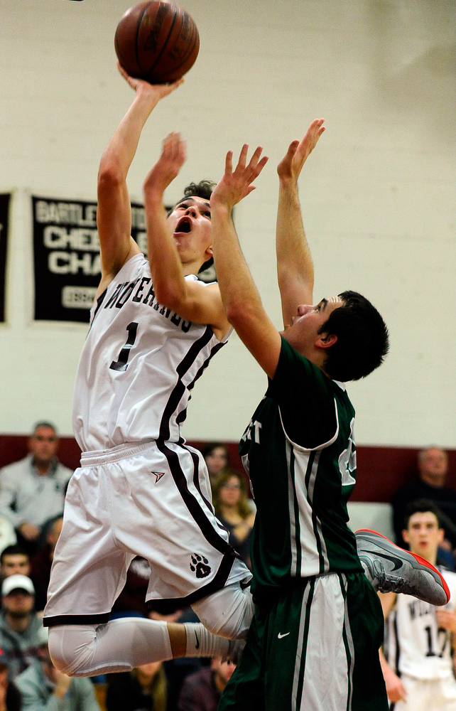 Leicester forward Ryan Stanick puts a shot past Bartlett forward Eric Sgariglia on Friday, Dec. 18, 2015.