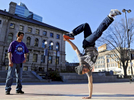 Tru Crew member Hector Ruiz-Colon of Worcester shows off his break dancing skills on the Worcester Common Oval as his friend Edwin Vasquez of Worcester watches on Saturday, March 19, 2016. The group was formerly known as TOP ROCK, The Only People Rocking Our City Kids.T&G Staff/Christine Hochkeppel