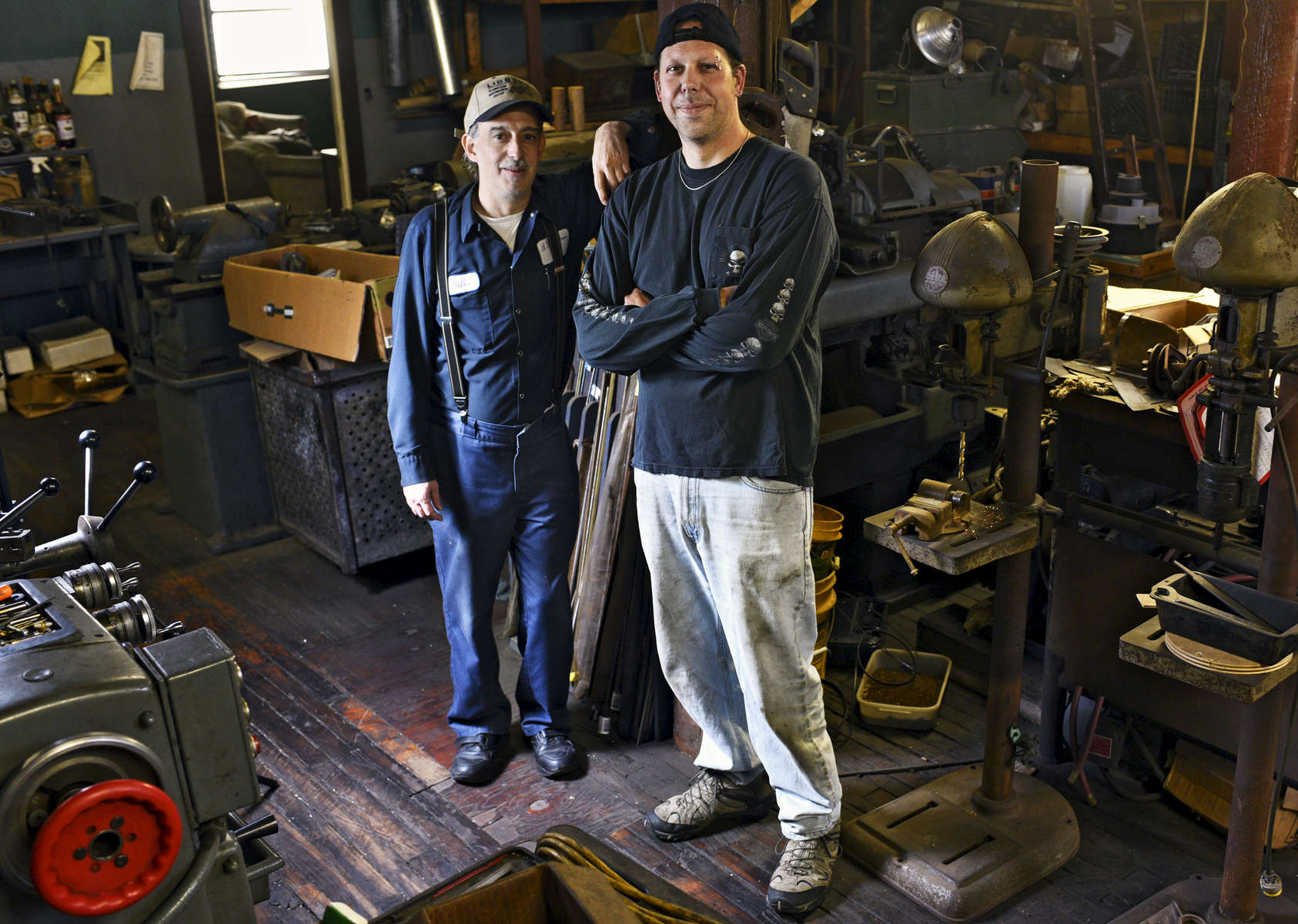 Michael Leveille, left, and Kevin Marcinkus of KM Lifestyle Manufacturing design and handcraft electrical and mechanical components for antique auto and radio collection. © Christine HochkeppelT&G Staff/Christine Hochkeppel